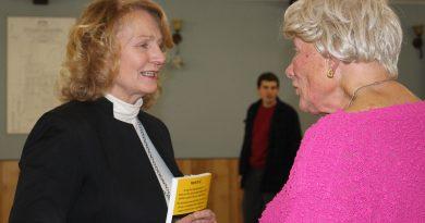 Karen McCrimmon speaks with a resident in Fitzroy Harbour.