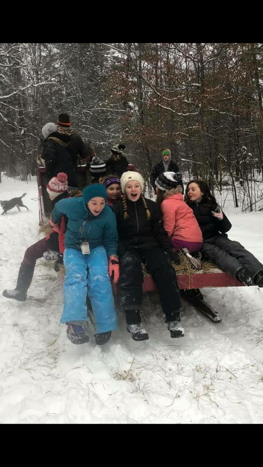 Kids enjoying a sleigh ride.