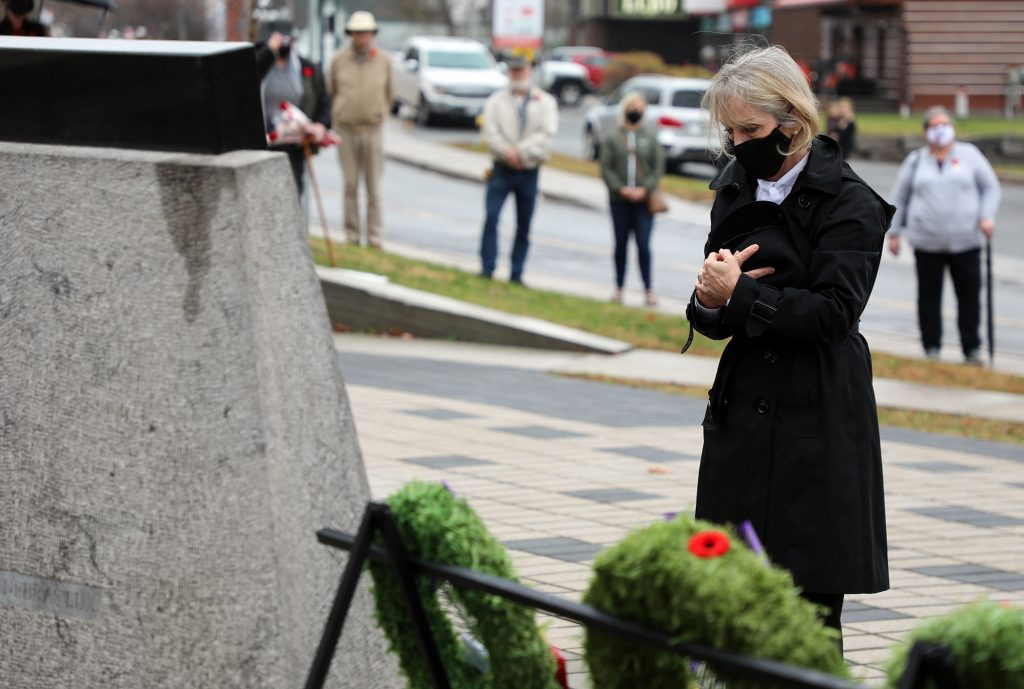 MPP Dr. Merrilee Fullerton lays a wreath during today's ceremony.