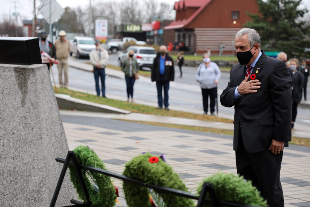 Coun. Eli El-Chantiry lays a wreath during today's ceremony.