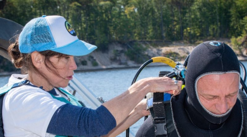 Ottawa Riverkeeper Elizabeth Logue assists Dr. André Martel with his gear before a dive last summer. Courtesy the Ottawa Riverkeeper