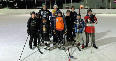A group of skaters pose on the Carp outdoor rink.