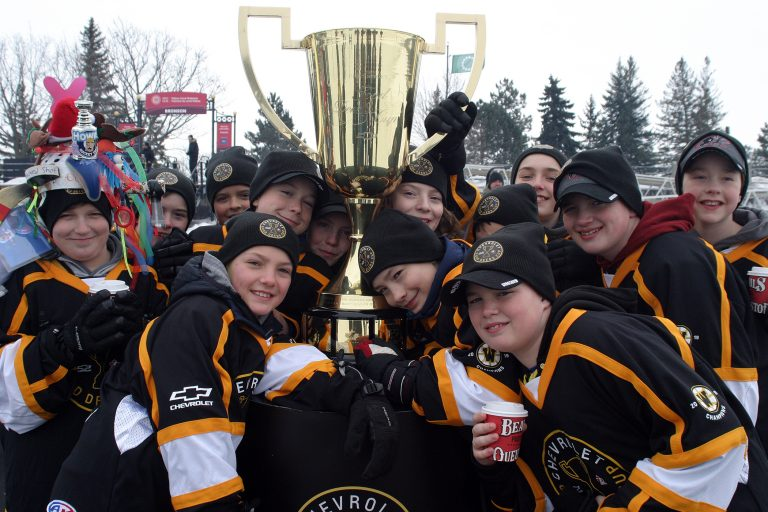 Warriors pose with the Good Deeds Cup.