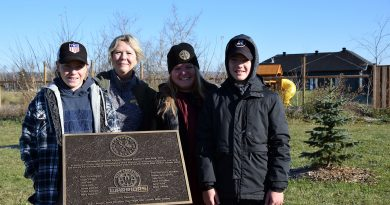 From left, Warriors Zack Hall, Kim Wood, Shelley Welsh and Blake Voelker pose with a plaque honouring the West Carleton Warriors' fundraising efforts.