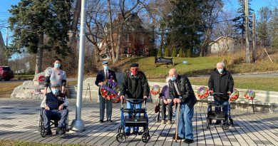 From left, Melanie Webber, Ken Micklethwaite, Rene Leroux, Walter Patterson, Margaret Micklethwaite, Maurice Vernoy (in back) and Edward Hedley pose for a photo at the West Carleton War Memorial. Veteran Clyde Bridle, not in the photo, was also present. Courtesy Carp Commons