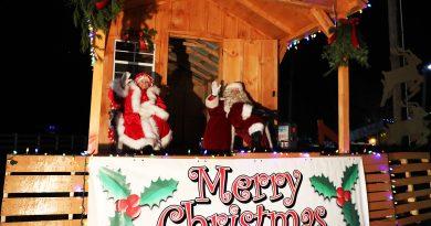 Santa and Mrs. Claus greet visitors to the 11th Annual Carp Santa Parade - Drive Thru Style, Saturday night.