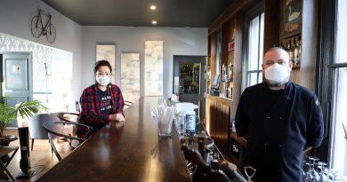 Sunny Na and Joe Thompson pose inside the bar of their Carp restaurant The Swan at Carp.