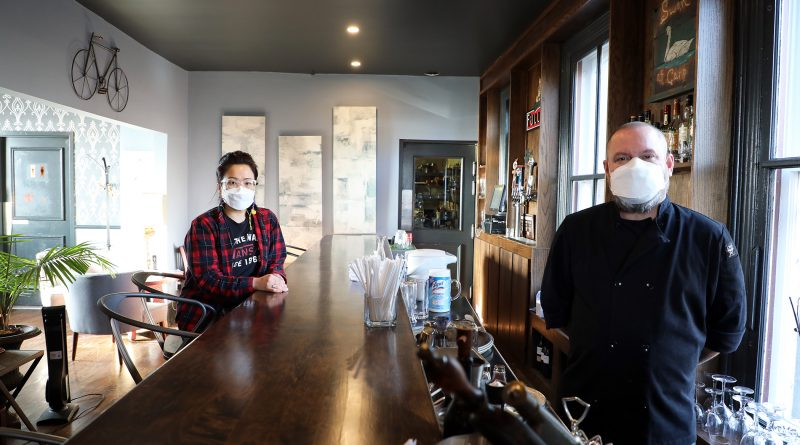 Sunny Na and Joe Thompson pose inside the bar of their Carp restaurant The Swan at Carp.