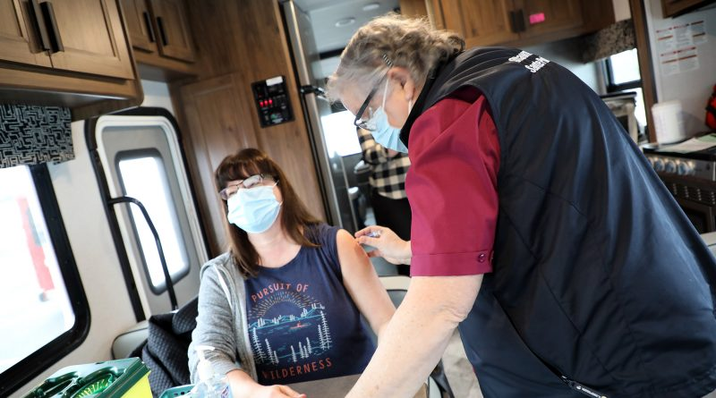 OPH lead nurse Genvieve Richer-Brule gives Dunrobin's Rebecca Holsten the flu shot last Friday.
