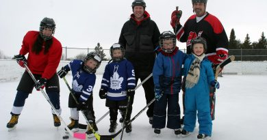 Skaters pose for a photo on the Corkery outdoor rink.