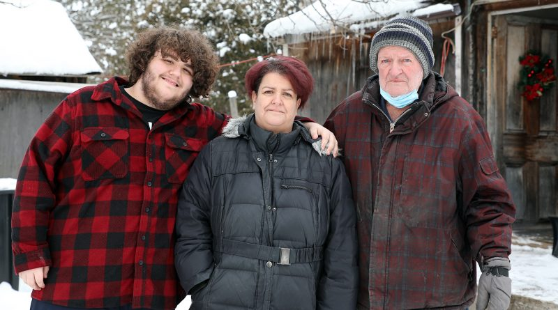 A photo of Joshua Tuepah, Brenda Coulter and Larry Coulter.