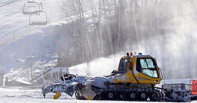 A ski hill groomer works on Mount Pakenham.