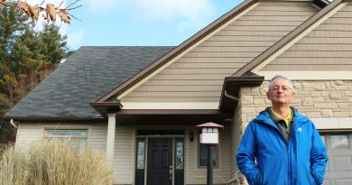 Kevin Goheen stands in front of his new home in Carp, Ont. He and his partner, Maureen McDonald, moved to the rural bungalow in September 2020.