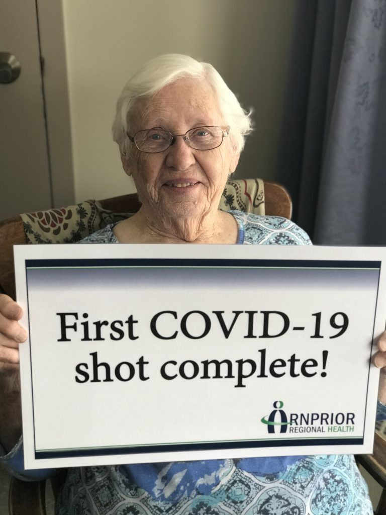 Grove resident Rita Colterman celebrates receiving her first inoculation of the COVID-19 vaccine.
