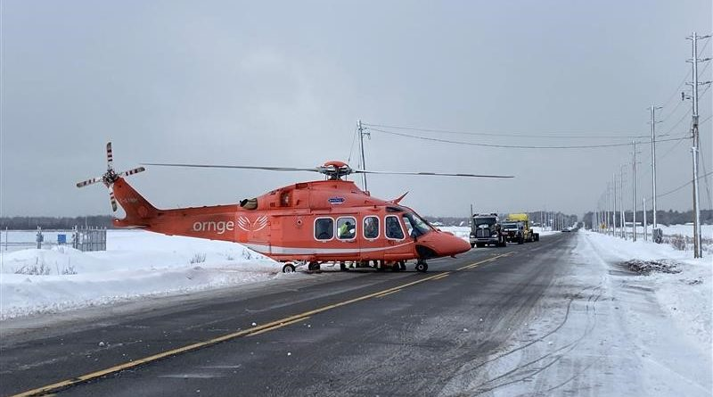 An ORNGE helicopter prepares to transport a patient to hospital.