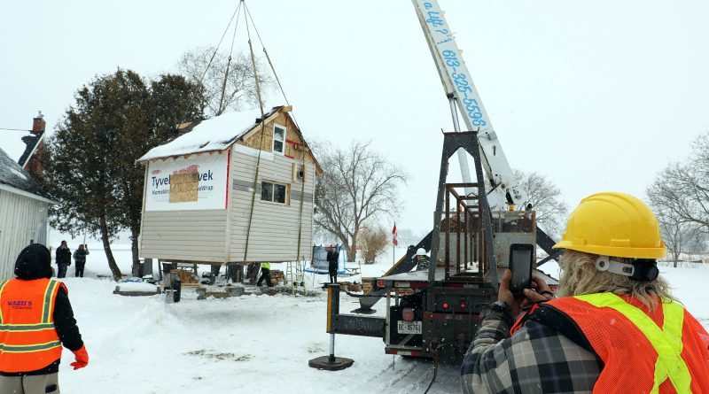 Guy Lamarche's bunkie is lifted in to the air.