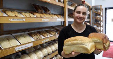 Valdete Nuhijaj shows off some of the Carp Bakery's bread.