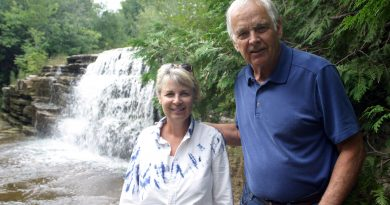 Lynn and Ron Grabe pose at Bradley Falls (in 2019) along Huntley Creek where redfin fish breed each year. The location is roughly one kilometre downstream from the location of the proposed concrete batching plan. Photo by Jake Davies