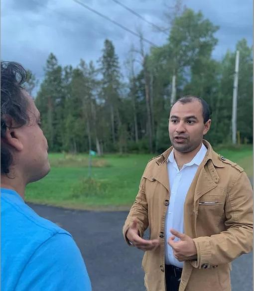 Alex Osorio talking to a resident.