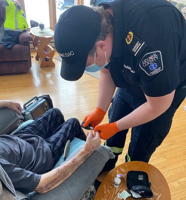 A community paramedic performs a home visit.