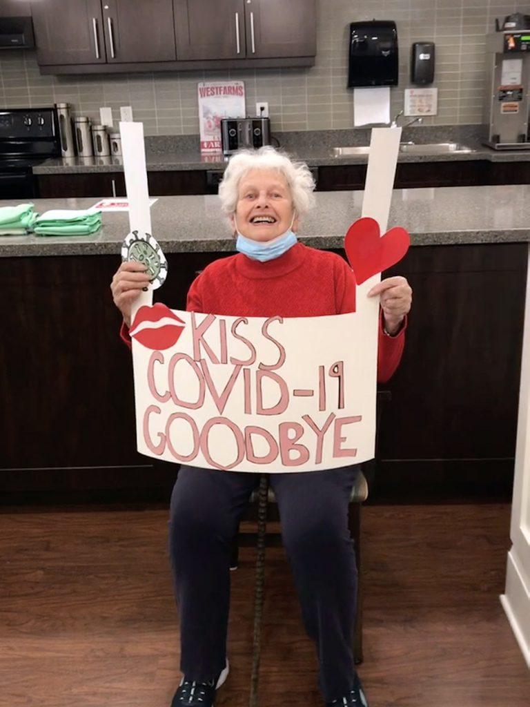 Jean Rattray celebrates her COVID-19 vaccination.