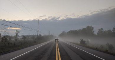 A photo of a foggy road in West Carleton.