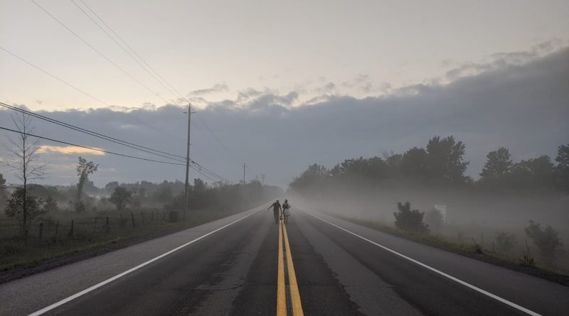 A photo of a foggy road in West Carleton.