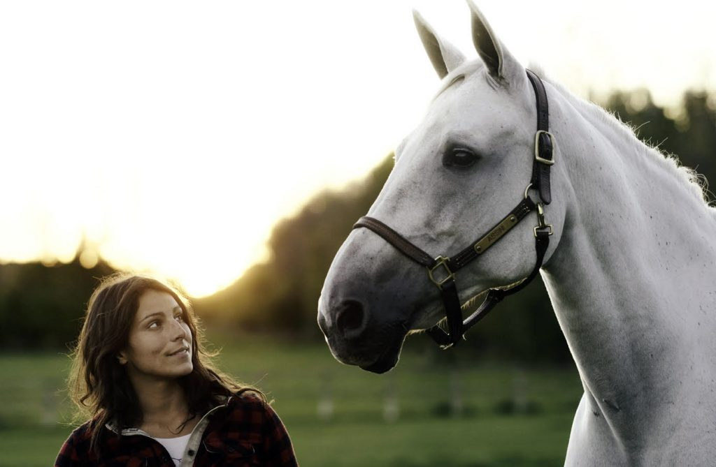 Charlotte Smith and a white horse.