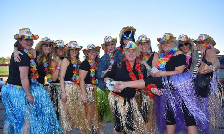 A photo of ladies in costume taken from the 2017 Carp Fair Ladies Night.
