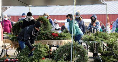 A photo of Carp Farmers' Market vendors wearing masks.