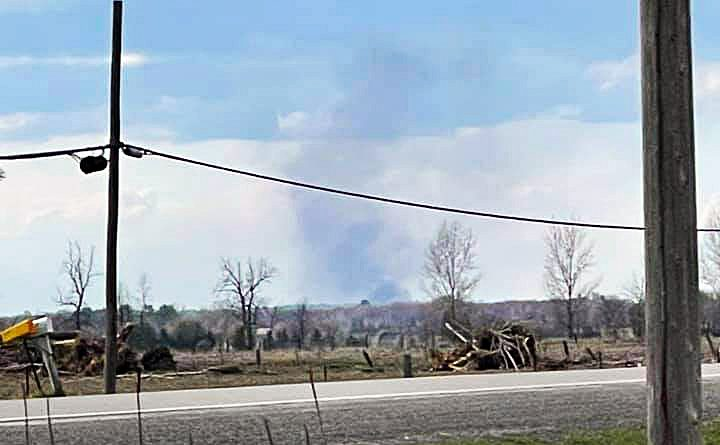 A photo of smoke rising from far away.