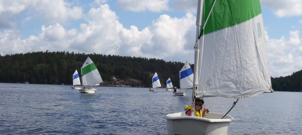 A photo of people sailing.