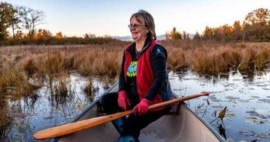 A photo of Pat Tait in a canoe.