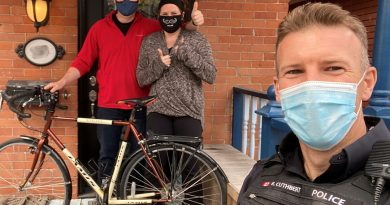 Const. Ryan Cuthbert returns a bike to its happy owners.