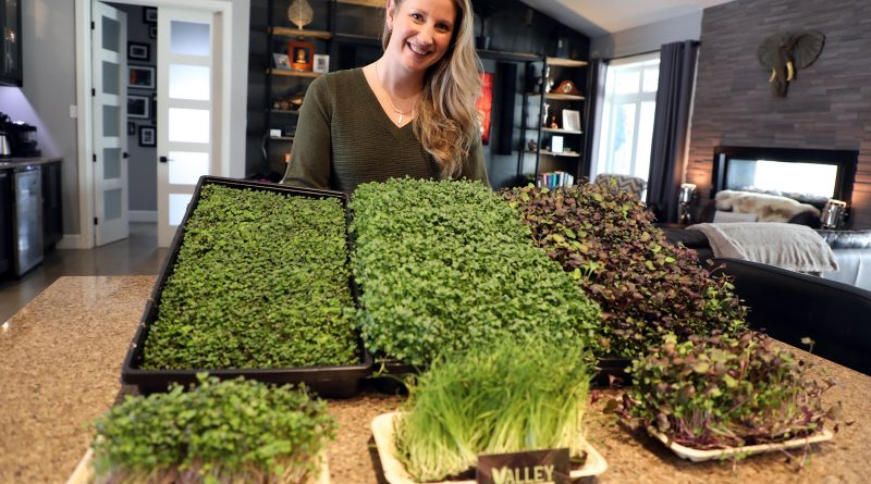 Leah Grassie and various microgreens.