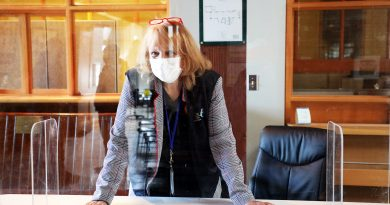 West Carleton's Kathy Watson-Lablanc poses behind a plexi-glass shield.