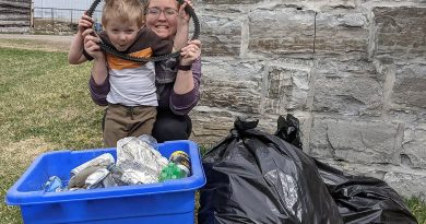 Bethany Braun and her son Weston show off their haul after spending time cleaning a one-kilometre stretch of Kinburn Side Road. Photo by Adam Braun