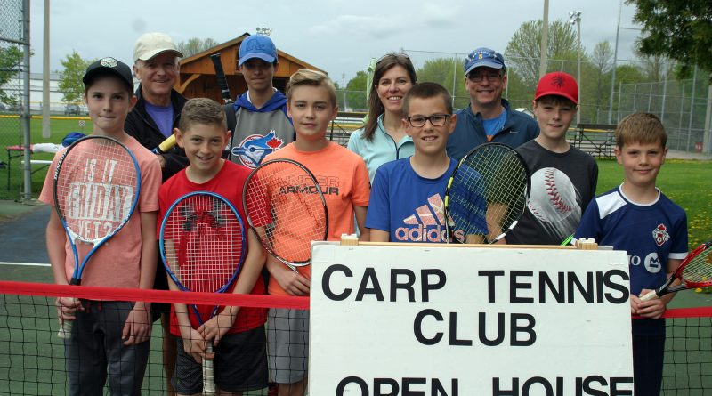 A photo of tennis club members.