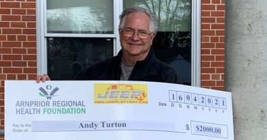 Andy Turton shows off his really big cheque.