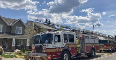 A photo of a fire truck battling the blaze.