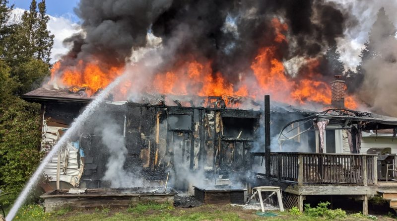 A Greely home is fully engulfed by flame.