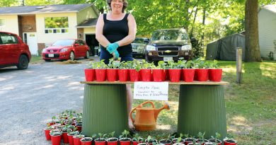 Shannon Spallin poses with her pumpkin seedlings.