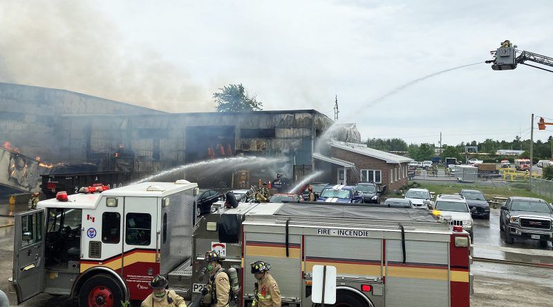 Firefighters battle a fire at a commercial building.