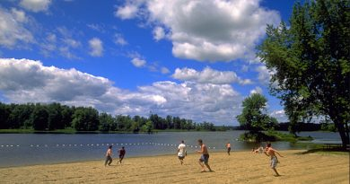 A photo of people enjoying Fitroy Provincial Park's beach.