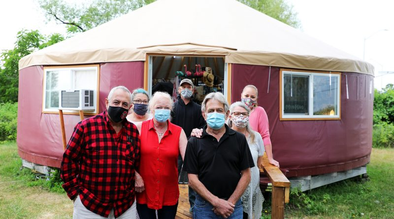 A photo of the Bowen family in front of the new yurt.