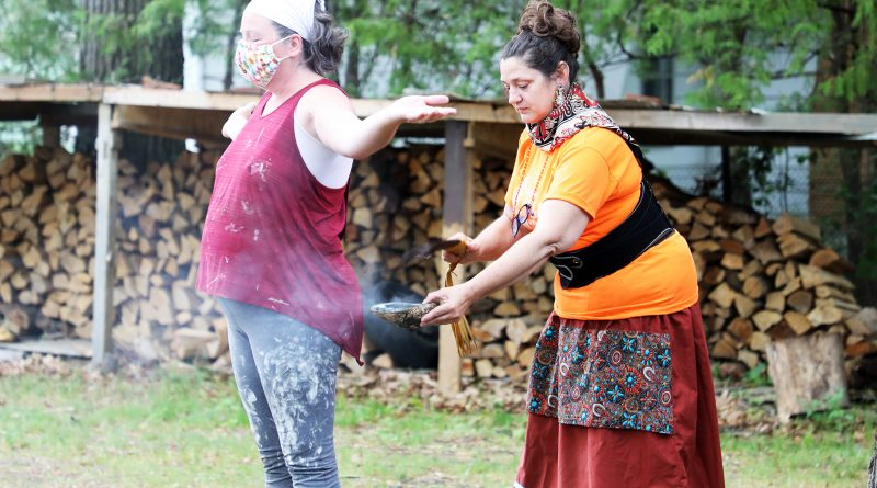 Ojibwa Heather Waganese smudges Constance Bay's Shannon Spallin.