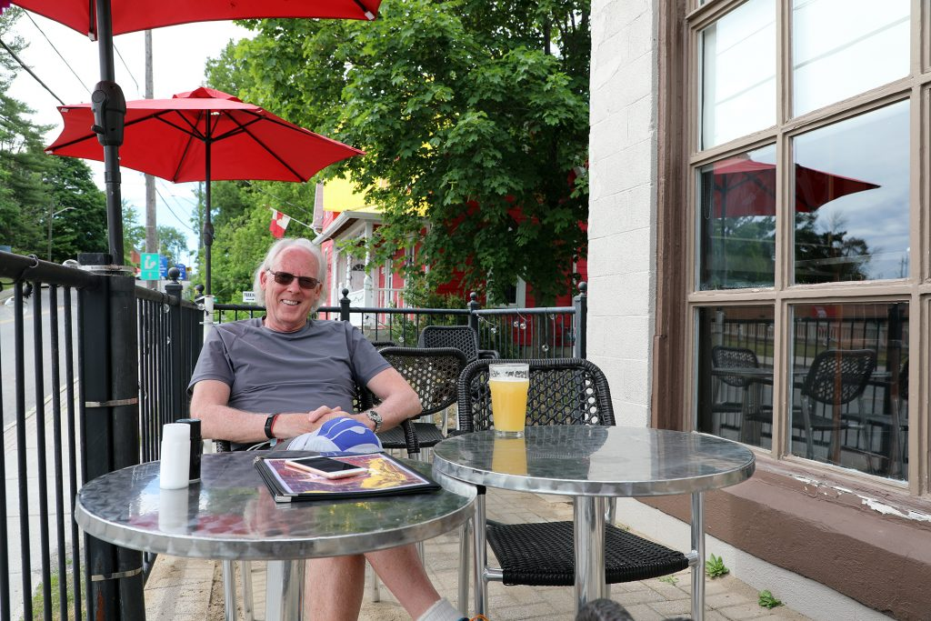 Doug Tansley sits on the Juke Joint patio.