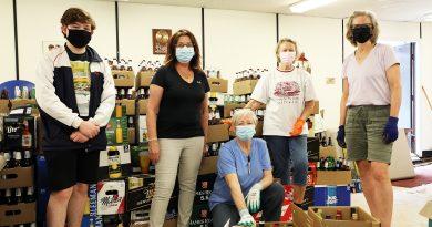 St. Garbriel volunteers pose in front of their bottle haul.
