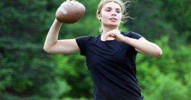 Anna King set to throw the football.