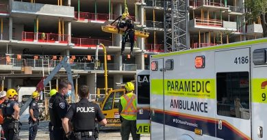 OFS crews lower the patient to waiting paramedics.